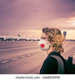 woman waiting for check-in in the airport lobby. Uses mouth and nose mask for protection against viruses. Canceled air services due to a coronavirus epidemic