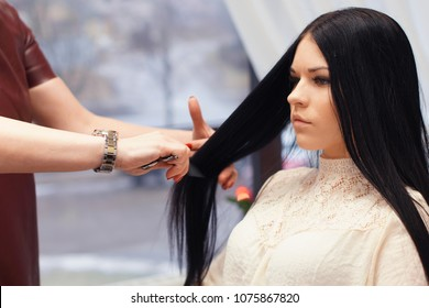 Woman waiting for styling hair in barber shop