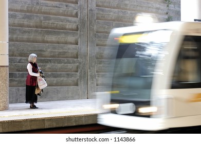Woman waits at the Los Angeles Gold Line train station in Pasadena California