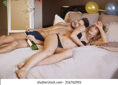 Woman waking up after crazy party