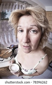 Woman waking up with a coffee (Dirty dishes fisheye)