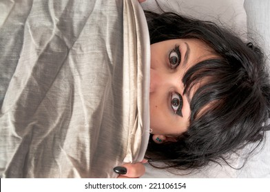 Woman waking up from a nightmare or night terror