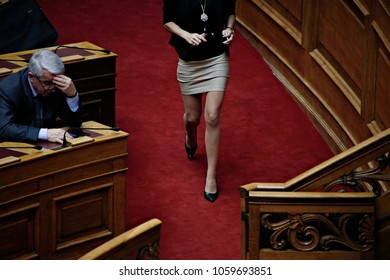 A woman walk inside the plenary hall during a discussion and voting on bill for legal recognition of gender identity in parliament, in Athens, Greece on Oct. 10, 2017