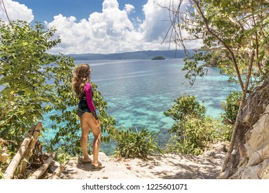Woman walk on the tropical island with palms tree on the beach. Asian travel to the Philippine islands