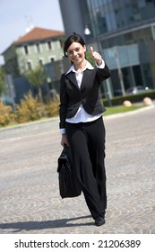 woman walk outdoors with thumbs up