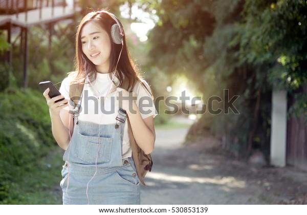 Woman Walk Park Outdoor Listening Music Stock Photo (Edit Now) 530853139