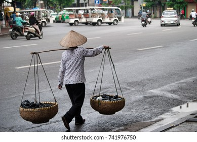 woman walk selling things in Hanoi,Vietnam