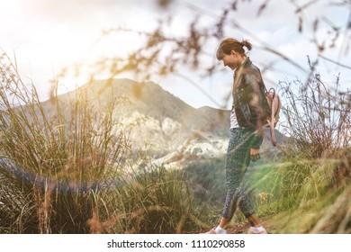 Woman walkin on mountain in morning. Bali island.