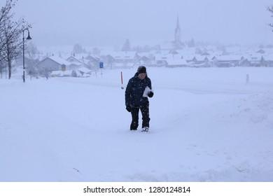 woman is walkin in the snow