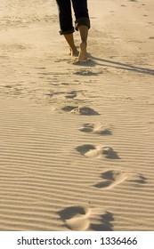 A Woman walking along the beach