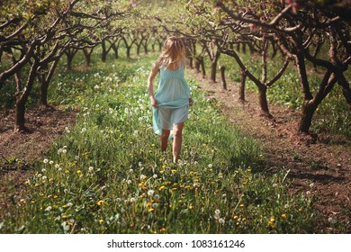 Woman walking among flowers . Peace and harmony