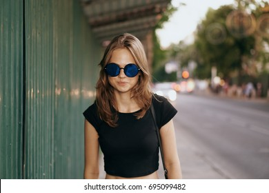 A woman is walking around the city