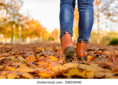 A woman walking at autumn season