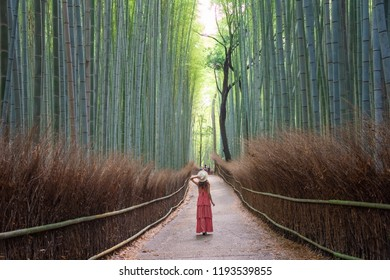 Woman walking in Bamboo forest, Arashiyama, Japan