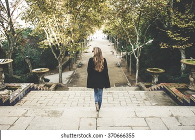 A woman walking down stairs in Barcelona, Spain