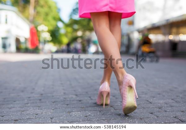 Woman walking down the street in high heels