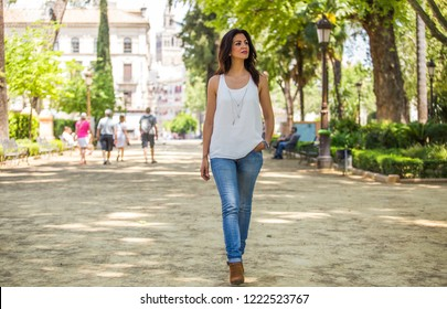 Woman walking at the downtown of Seville, Spain