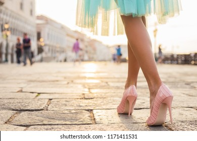 Woman walking in high heel shoes in old city