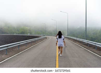 A woman is walking lonely
