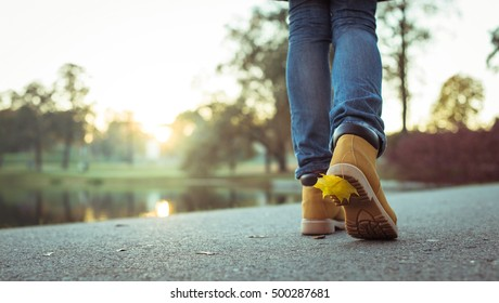 Woman walking with maple leaf on shoe sole