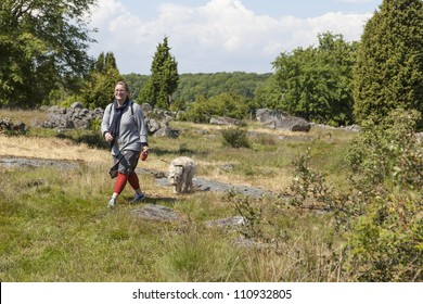 Woman walking in nature with her dog