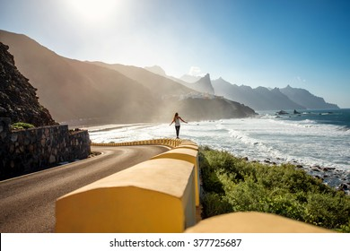 Woman walking near the mountain road near Taganana village on Tenerife island