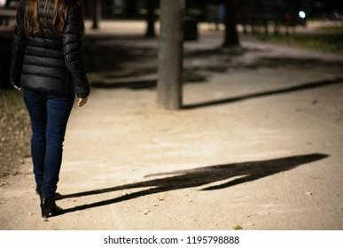 Woman walking at night