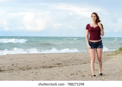 woman walking on beach after a storm