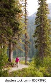 Woman Walking on Remote Lakeside Trail