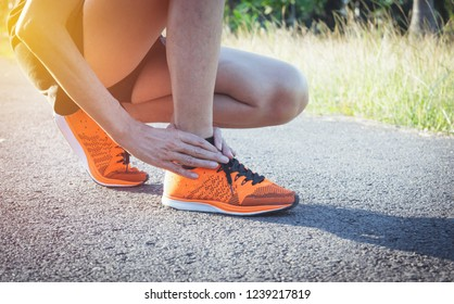 Woman walking on the road get accident on her ankle the image is for health concept.