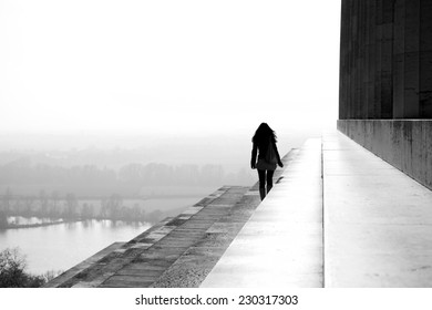 Woman walking on a roof of the world
