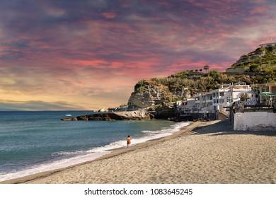 woman walking on seaside of Ischia island