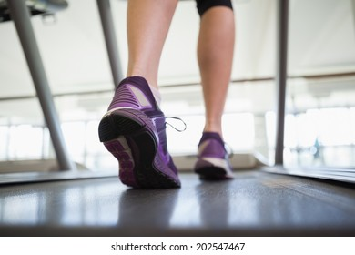Woman walking on the treadmill at the gym
