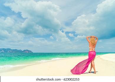woman walking on tropical beach vacation. summer holiday travel