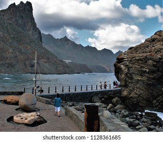 woman walking on Walkway to visit the cliffs, Tenerife, Taganana, landscape of the coast of Tenerife in the Atlantic ocean