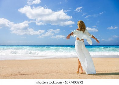 Woman walking on the wild beach of the island of Lefkada in Greece