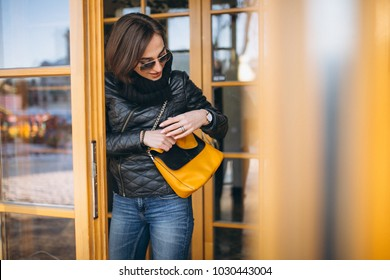 Woman walking out of restaurant in jacket