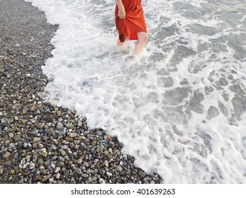 woman walking over the shore in summertime
