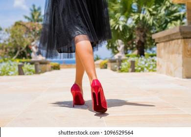 Woman walking in red high heels