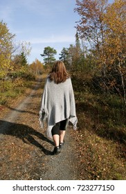 Woman walking in a rural autumn landscape