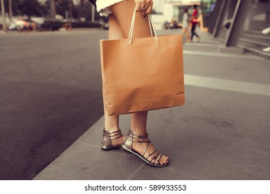 Woman walking with shopping bags with mall.