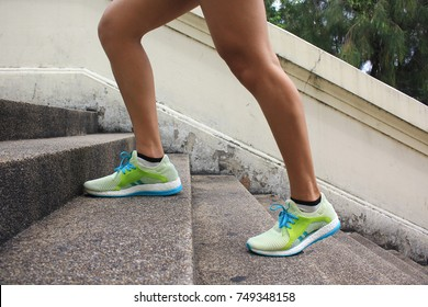 Woman walking up the stairs, Fitness woman legs running and burn fat in the body, Healthy lifestyle concept