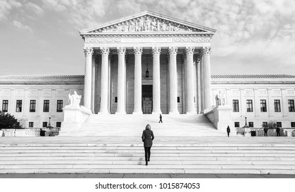 Woman Walking Up The Stairs Of Supreme Court of the USA