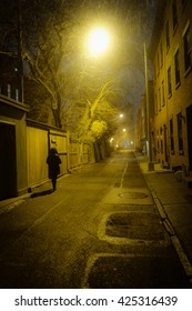 Woman walking the streets of Brooklyn by night