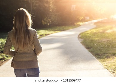 Woman walking at sunset