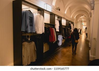 woman walking through shopping aisle