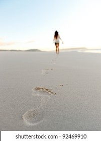 woman walks alone on a deserted beach, solitude, serene, lonely concept. carefree vacation in nature