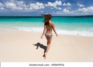 Woman walks on the beach