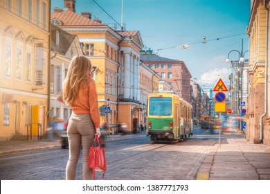 A woman walks through the center of Helsinki. Finland.