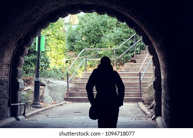Woman walks through NYC Tunnel